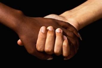 Interracial women holding hands