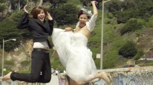 Lesbian couple in their wedding gear.