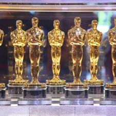 A collection of Oscar statuettes for the Academy Awards.