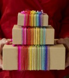 holiday gifts with rainbow wrapping