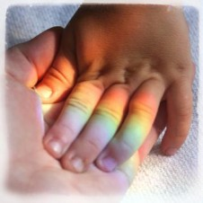 Rainbow family holding hands
