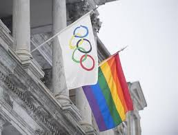 A rainbow flag flying over city hall alongside the Olympic flag in Montreal, Canada during the Sochi Olympics. (Photo: The Canadian Press/Graham Hughes)