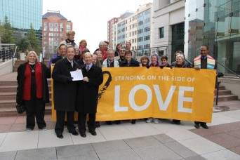 Same sex marriage supporters gather at Arlington County courthouse.