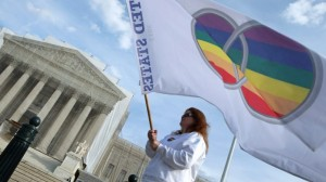 Marriage equality protester with rainbow flag outside US Supreme Court