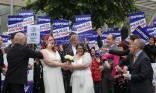 Jaye (left) and Ruth Richard-Hill from Glasgow, in a mock marriage ceremony outside Scottish parliament in Edinburgh (Photo: Andrew Milligan/PA)