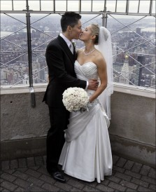 Stephanie Figarelle, left, and Lela McArthur as they wed atop the Empire State Building, Valentine's Day 2012.