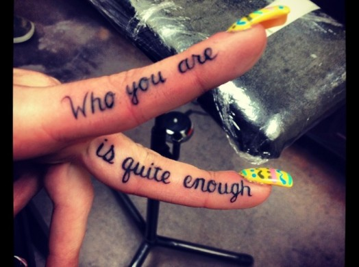 who you are is quite enough tattoo on fingers