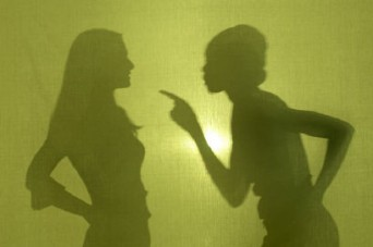 Silhouette of two women arguing